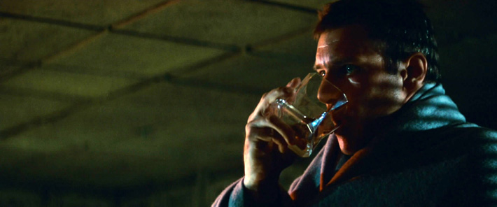 Deckard drinking out of the glass.